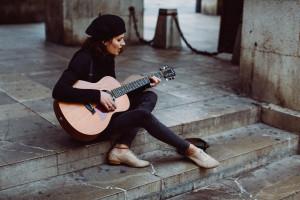 Holly JK singer songwriter musician in Mallorca busking
