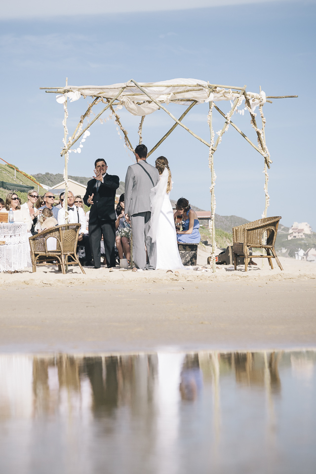 Holly J. Kotzé professional singer and acoustic guitarist performing at an outdoor beach ceremony in South Africa
