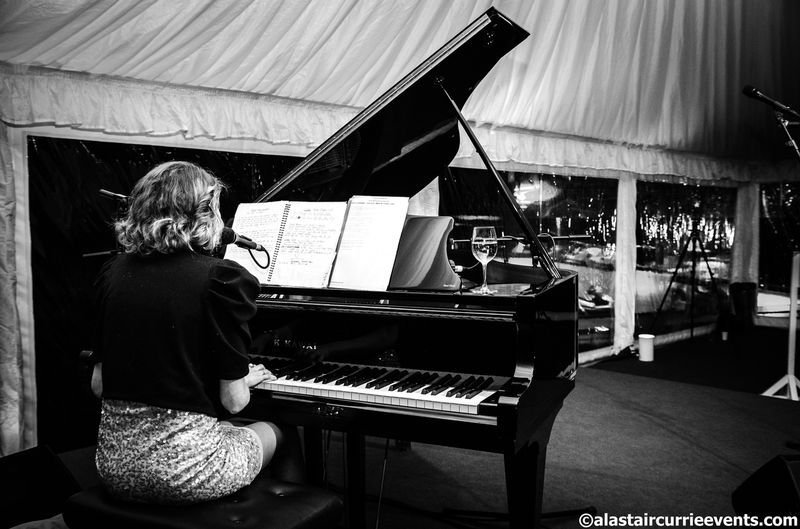 Holly J Kotzé professional pianist singer performing at an exclusive birthday party near Bristol