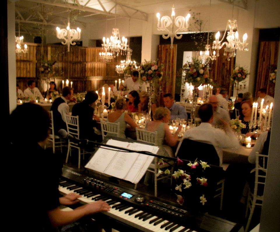 Holly J. Kotzé Professional Pianist Singer playing during wedding breakfast at Molenvliet wine estate, South Africa.