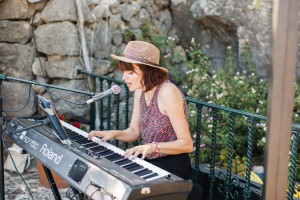 Me playing at the wedding drinks reception by the pool at Pedruxella Gran Olive Estate in Mallorca.  Photo by Emma Fenton